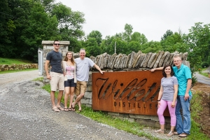 The group, at the entrance to the distillery grounds.
